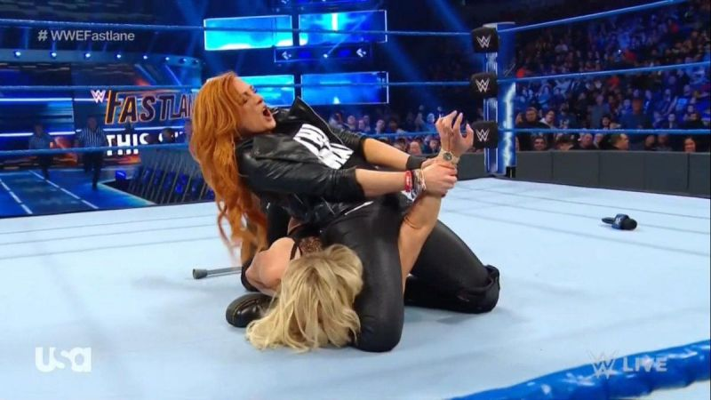 Becky Lynch destroyed Charlotte Flair with one good leg.