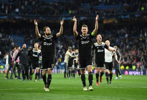 Matthijs de Ligt (right) celebrates after knocking Real Madrid out of Champions League