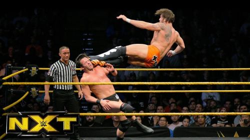Shane Thorne nails a dropkick on Roderick Strong