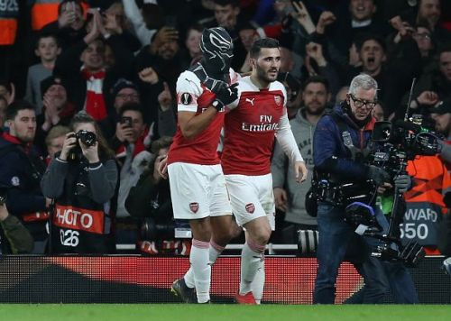 Aubameyang celebrates his second goal with Sead Kolasinac to gift Arsenal a slender lead over the two legs