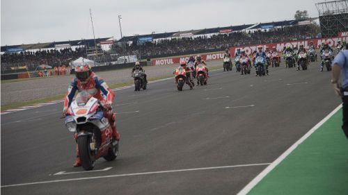 Marc Marquez attempts to restart his bike on the grid.