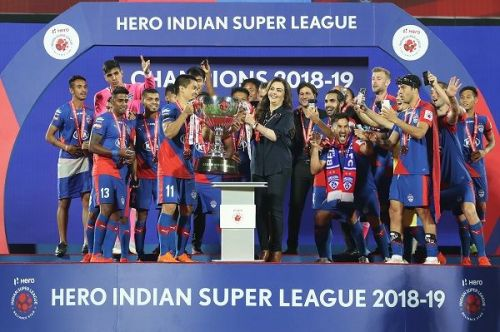 Bengaluru FC players with the ISL trophy