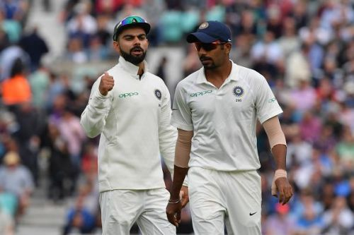 Virat Kohli (L) and Jasprit Bumrah