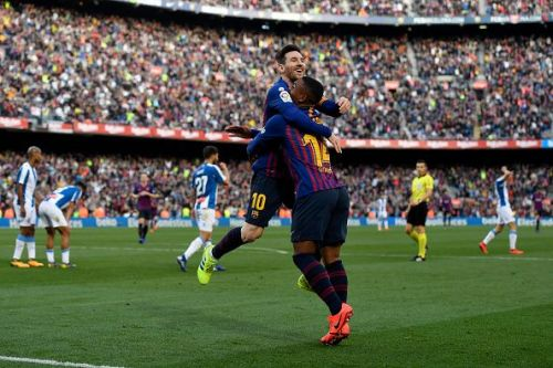Messi celebrates with substitute Malcom after netting Barca's second goal during their 2-0 win vs Espanyol