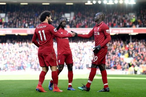 Mane (far right) celebrates his second goal with Salah and substitute Keita during their win