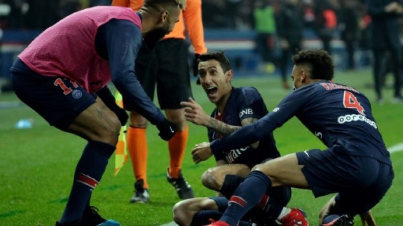 di Maria celebrates with his teammates during their 3-1 win over Marseille before the international break