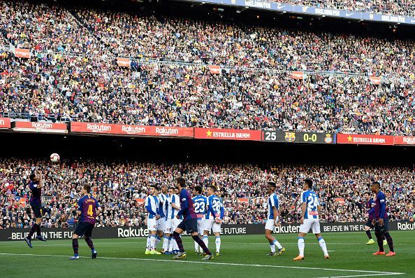 Messi watches his audacious free-kick as it floats goalwards to break the deadlock against Espanyol