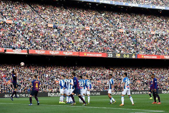 Messi watches his audacious free-kick as it floats goalwards to break the deadlock against Espanyol