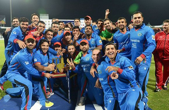 Afghanistan team celebrates after beating Zimbabwe in an ODI series.
