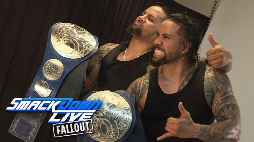 The Usos celebrating with the SmackDown Live Tag Team Championship