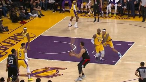 Kuzma shoves LeBron James (No. 23) to close the open shooter.