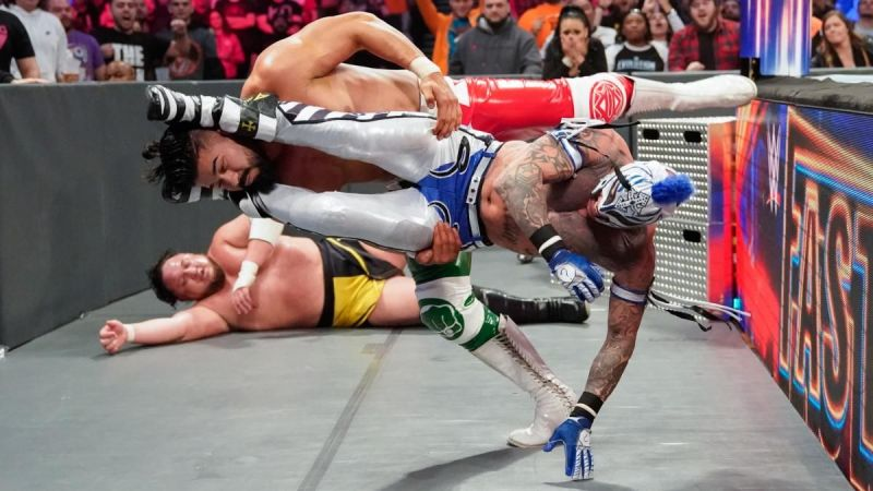 Rey Mysterio and Andrade in action