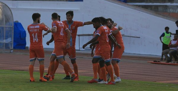 Chennai City FC players celebrate after a goal