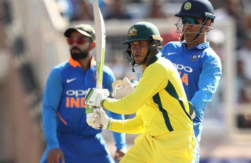 Usman Khawaja struck his maiden ODI ton to help Australia beat India.