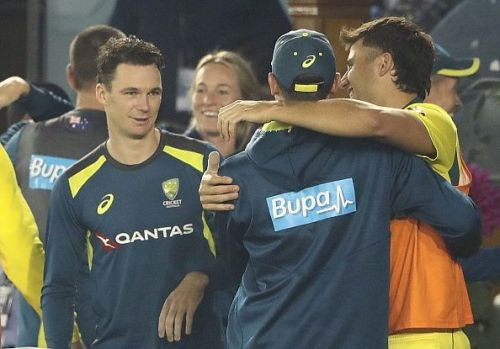 Aussies celebrating after the historic ODI win against India
