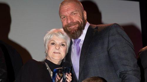 2019 Warrior Award recipient Sue Aitchison with Triple H