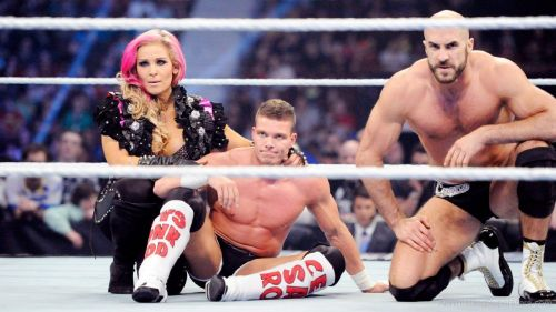 Kidd, with wife Natalya, and Cesaro, whom he held the Tag Team Titles with.
