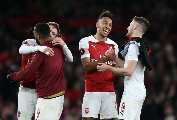 Arsenal celebrate their win against Stade Rennais in the UEFA Europa League Round of 16: Second Leg