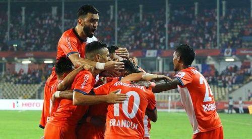 Goa players celebrate after Corominas' goal