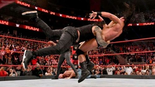 Roman Reigns spears Drew McIntyre