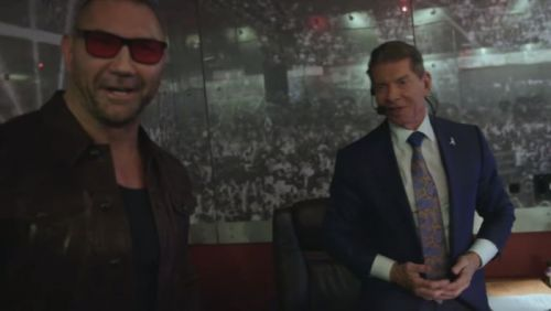 Batista and Vince McMahon backstage.