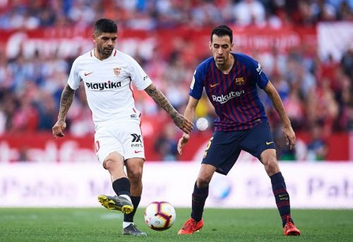 Banega battling with Busquets for possession during a recent league fixture between the pair