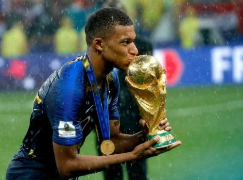 Kylian Mbappe with the FIFA World Cup