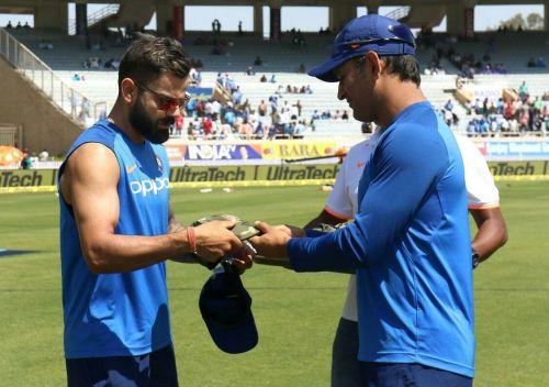 Dhoni presents army cap to Indian captain Virat Kohli