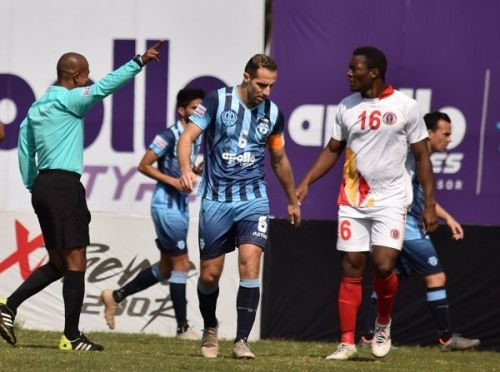 Mahmoud Al Amna (centre) of Minerva Punjab