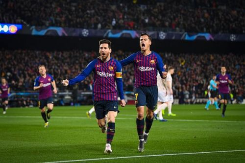 Messi and Coutinho wheel away, celebrating one of the goals during a demolition job vs Manchester United