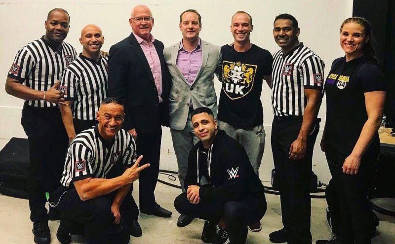 Tom Castor (second from left) broke his leg