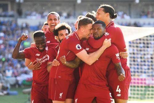 Liverpool players celebrate after Wijnaldum's goal against Cardiff
