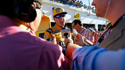 Kyle Busch talks with reporters