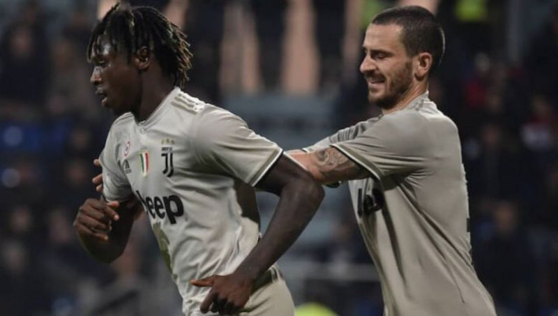 Leonardo Bonucci pulls Moise Kean away from the Cagliari fans