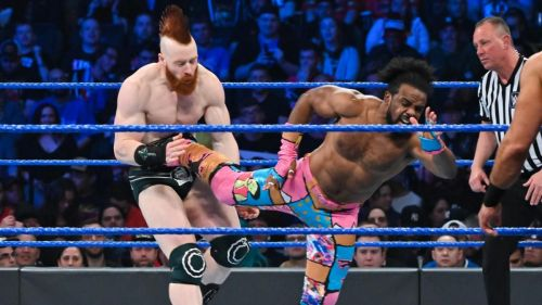The New Day faced off against The Bar and RAW's Drew McIntyre, in a bout that saw WWE Champion Kofi Kingston get the pinfall victory.