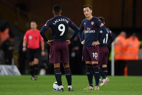 Alexandre Lacazette and Mesut Ozil look dejected after Arsenal's loss to Wolves