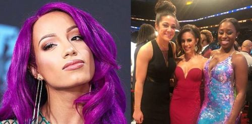 Sasha Banks (far left) and Naomi (far right) are both regarded as top-tier WWE Superstars