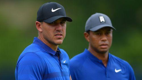 Brooks Koepka (left) and Tiger Woods