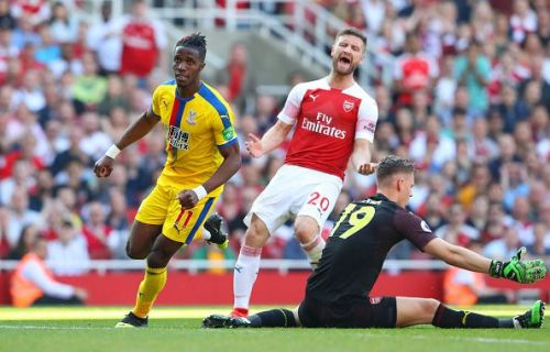 Mustafi reacts after Crystal Palace's Wilfried Zaha scores a goal against Arsenal