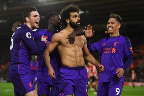Mohamed Salah celebrates with his teammates