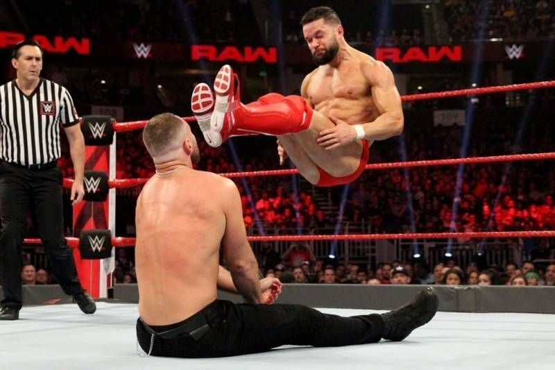 Finn Balor and Dean Ambrose facing off on Raw