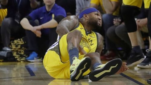 Cousins winces in pain after going down in the first quarter of Game 2.