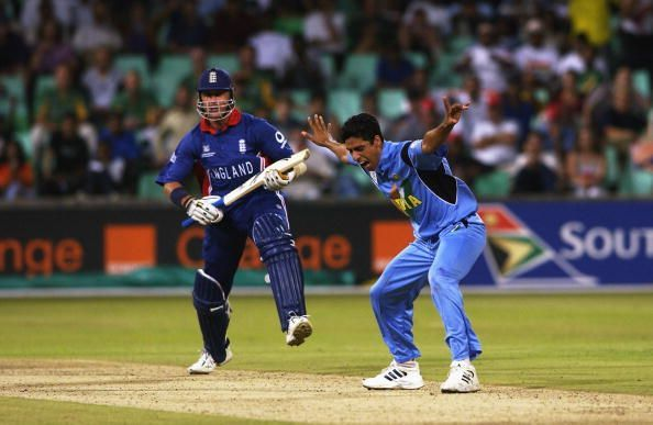 Ashish Nehra of India celebrates the wicket of Alec Stewart of England