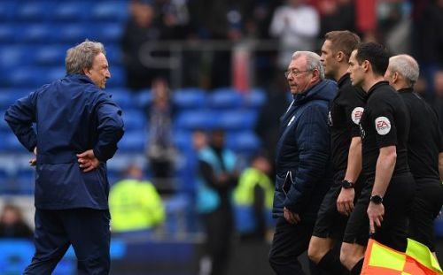 Neil Warnock has a stare down with the refereeing team after full time against Chelsea FC
