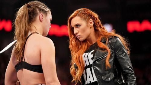Charlotte Flair versus Ronda Rousey versus Becky Lynch. Who wins?