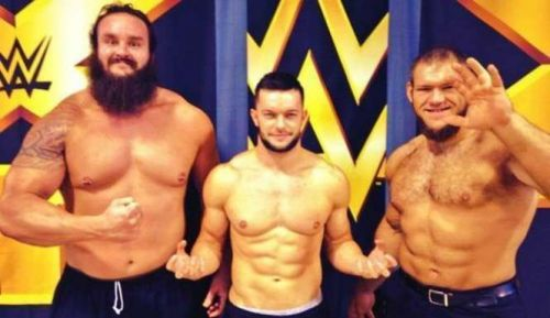 Finn Balor with Braun Strowman and Lars Sullivan
