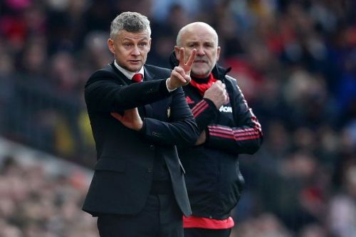 Ole Gunnar Solskjaer (l) and Mike Phelan (r)