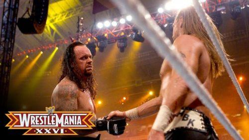 Undertaker shaking Shawn's hand after retiring him