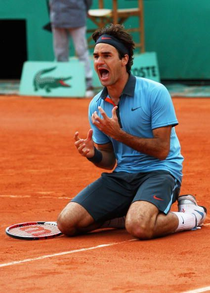 Federer winning the 2009 French Open and the Career Grand Slam