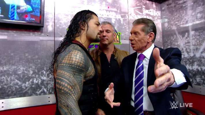 Roman Reigns with Shane and Vince McMahon